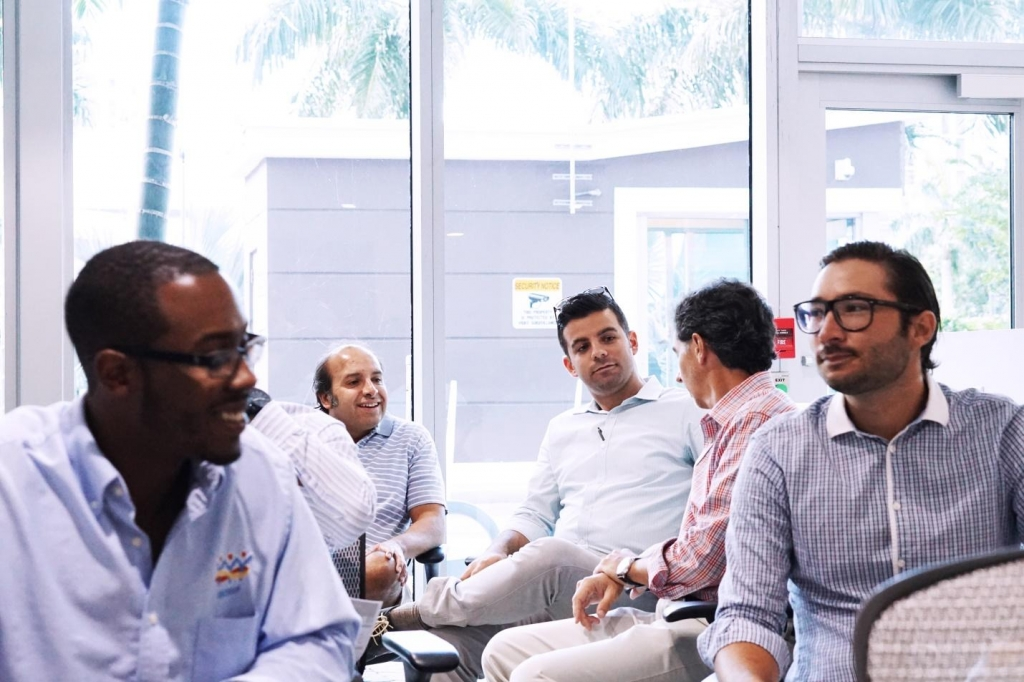 A group of visitors share ideas on the Founder's Institute Information Session on August 11 2015